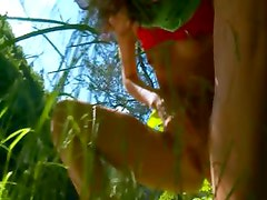 Petite czech chick peeing in a forest
