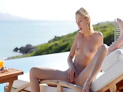 blond babe Leila naked in the sun