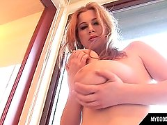 Huge natural tits Terry Nova playing with her tits on the window