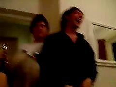 Drunk guy at a party dancing in a thong for friends