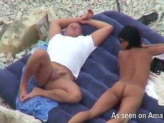 Brunette milf touched on the beach by her hubby