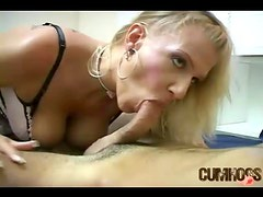 Blonde hottie in corset stroking cock with her mouth