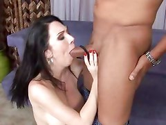 Big black package gets sucked and rubbed til it cums by a pale Rayveness