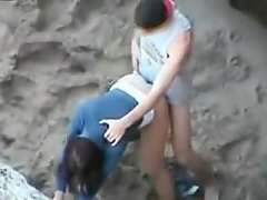 Hot teen couple caught fucking on the beach by a peeper
