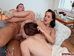 Lusty stepmom threesome sex on the couch