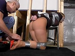 Blonde Taped to Pole