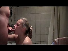 Amateur wife Jana sucking cock and getting a facial in bathroom.