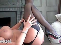 Busty blonde babe peels off silky dress and wanks wet pussy in sexy nylons