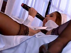 Nurse Cathy Heaven is caught playing with her pussy