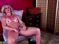 Blonde MILF undressing and masturbating