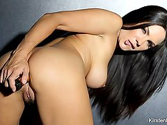 Busty brunette Kirsten Price toys her ass