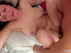 Busty mature gets pounded on the couch
