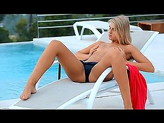 Young blonde girl fingers by the pool