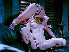 Blond lesbians toying with dildos and strapons