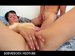 A pretty brunette milf fucked by a young