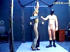 Girl With Tied Arms And Pvc Overall Whipped Fingered Spanked By The Master In The Dungeon