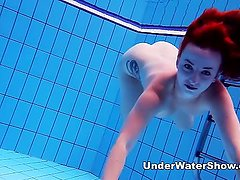Underwater Show - redheaded cutie swimming nude in the pool