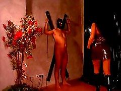 Mistress in latex tortures her slave