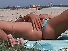 Some pissing fun on the beach!