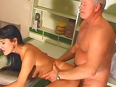 Old and hungry fucker is satisfying his classy brunette