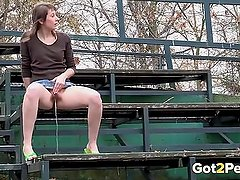 Hairy girl lifts her skirt and pisses outdoor