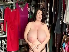 Huge beautiful woman rubs her tits for her horny photographer