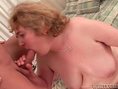 Chubby mature slut gets oiled up then gives blowjob