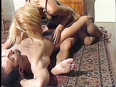 Short haired tranny sucks on guys cock and jerks off another cock in threesome