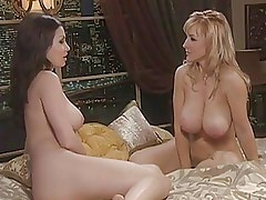 Aria Giovanni and busty blonde hold a naked conversation