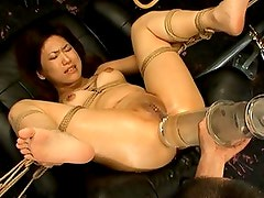 Mari Kamiya has her legs spread wide and ass played with