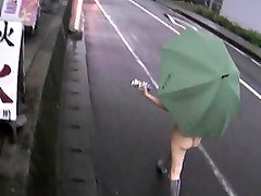 Yuka Kurihara walks naked flashing the public in the rain