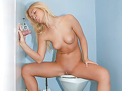 Blonde chick needs to visit the toilet for it