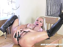 Blonde biker babe Michelle Thorne covered in oil wanks big black dildo toy