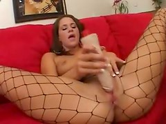 Sensual slut in fishnets dildo fucking