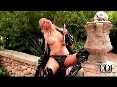 Kinky minx in latex fucks the hilt of a sword