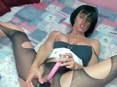 Busty slut in ripped pantyhose plays with cunt
