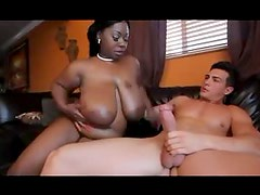Black BBW gobbles big white cock