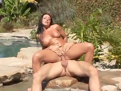 Cherokee in shiny gold swimsuit has sex outdoors