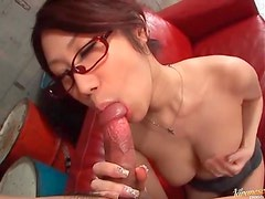 Cute Japanese girl in glasses sucks cock