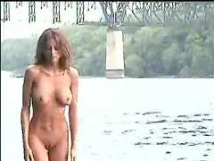 Dirty girl washes her nude body in the river