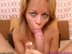 Blonde cougar with huge jugs giving a titjob