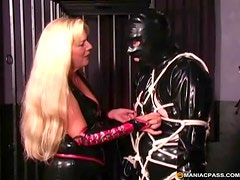 Kinky blonde dominatrix tieing up her male sex slave