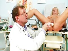 Dirty doctor inserting a blonde grandma