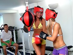 Two sexy babes share a dick in the gym