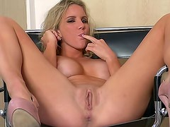 Lusty Ainsley Addison is satisfying her pussy on the chair