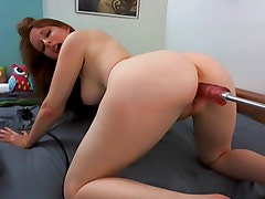 Redhead with huge Ass plays with her Fuckmachine