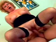 Horny old granny in fishnets fucking