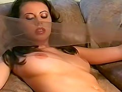 Young and frisky brunette is satisfying her natural boobies