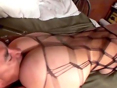 Shaved blonde facesitting in a fencenet bodystocking