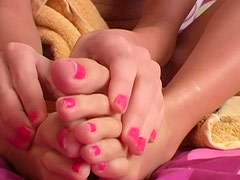 Close up rubbing of lotion into soft feet